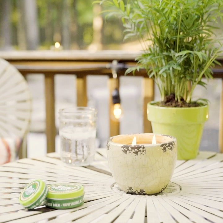 Load and play video in Gallery viewer, murphys naturals mosquito repellent garden candle on patio with two friends