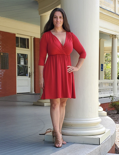 "Look gorgeous with this versatile any-season faux wrap dress. This dress has a cross over bodice to give you a feminine accentuation and an elastic empire waist to give your shape a boost! The fabric is legit buttery soft. There is no exaggeration here!   The length is absolutely perfect at the knee making it an ""anywhere / anytime"" dress. You can dress up or dress down this piece by adding some heels or wedges or even flip flops.    pssst....surprise! There's pockets."