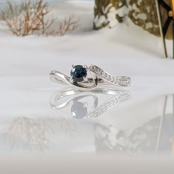 10K white gold and diamond natural blue sapphire ring set with .06cttw in round brilliant cut diamonds. Finger size 6.75. $980.00