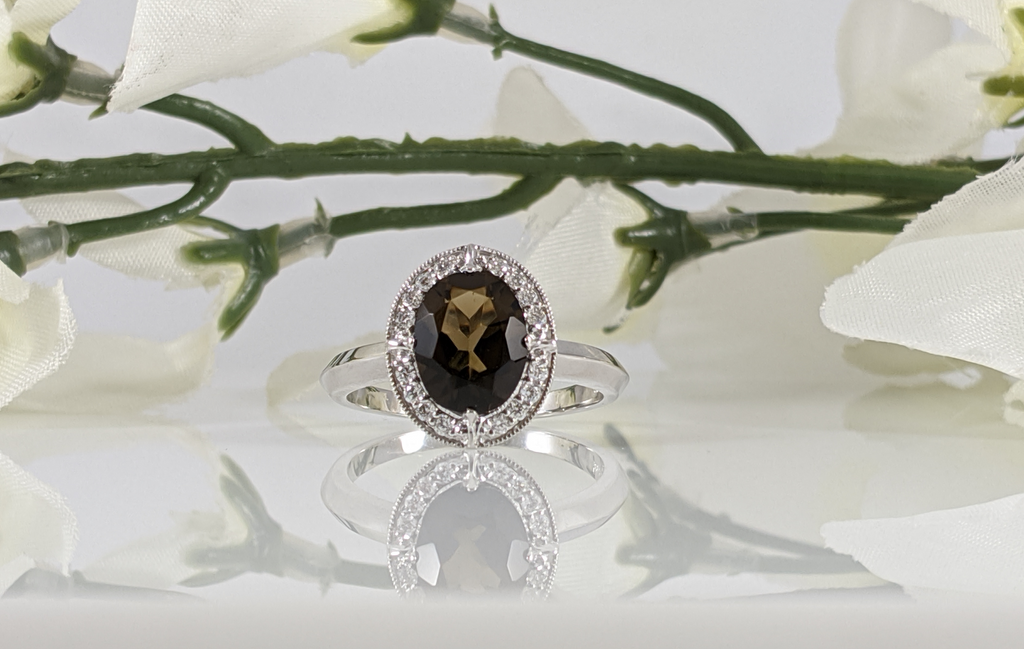 14k white gold and diamond smokey quartz ring with 9x7mm quarts and .15cttw in diamonds