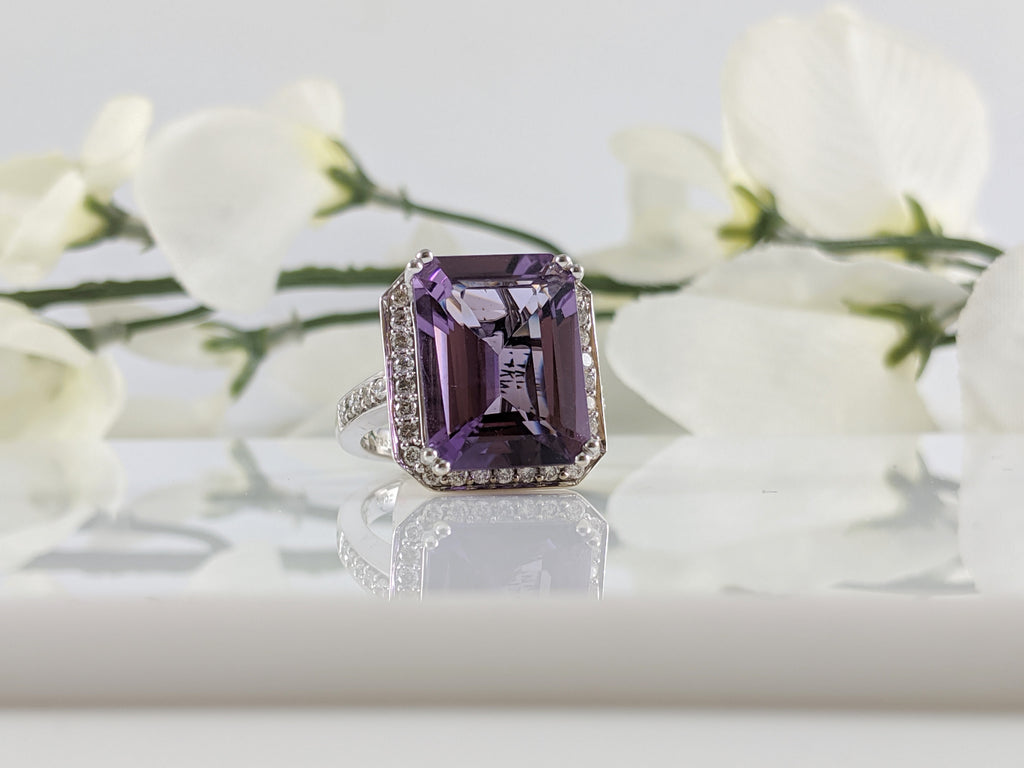 Gorgeous 14K white gold and Amethyst diamond ring. Center stone is a 15.80mm by 11.94mm emerald cut Amethyst with an additional .64cttw in diamonds. Finger size 6.5.  $1375.00