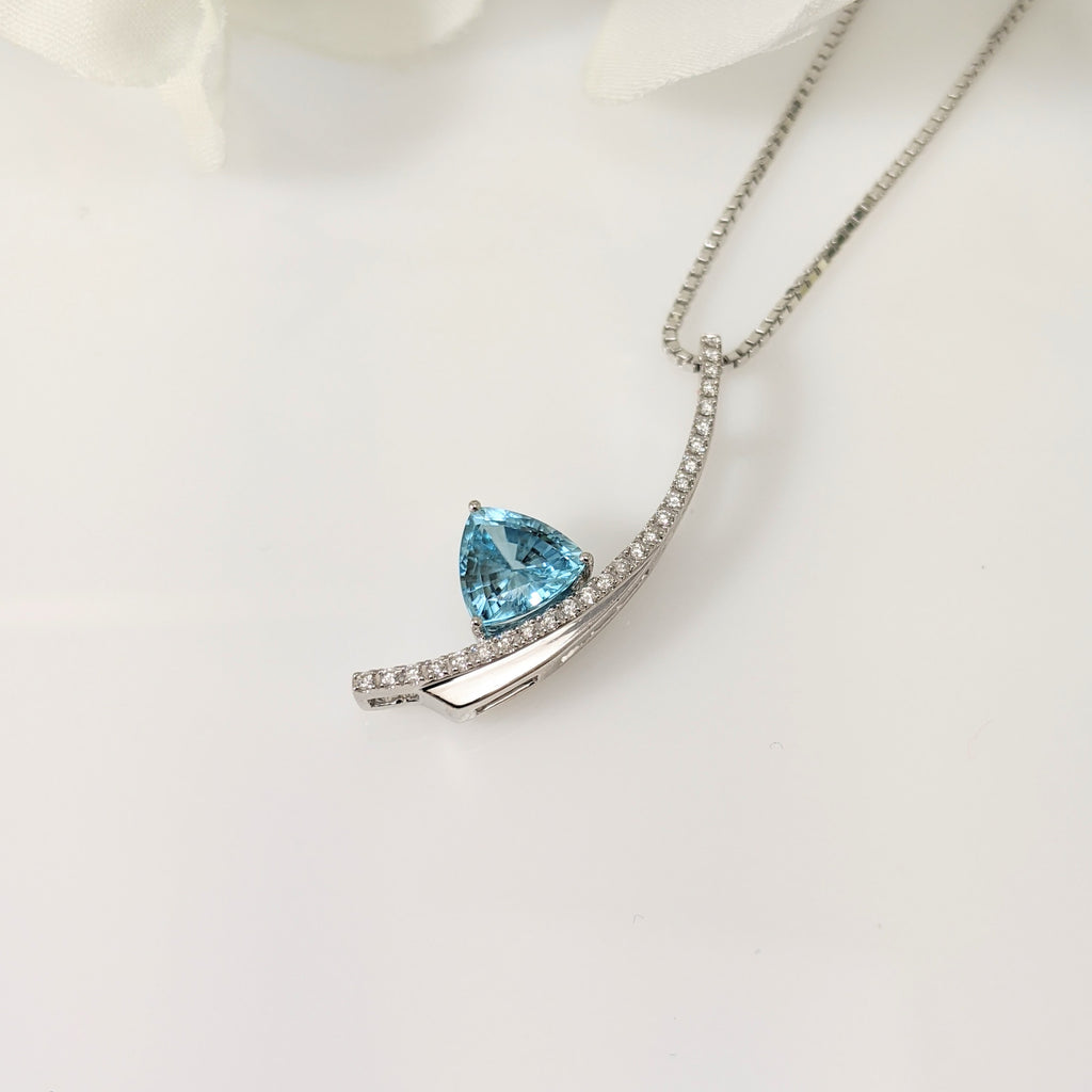14k white gold and diamond trillion cut blue topaz pendant