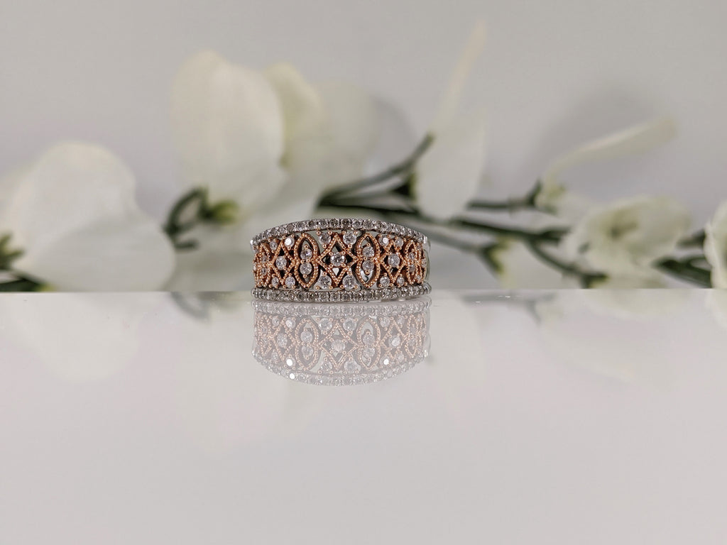 Featuring a half carat of round brilliant cut diamonds this stunning white and rose gold ring is a fabulous deal! Finger Size 7. $795.00