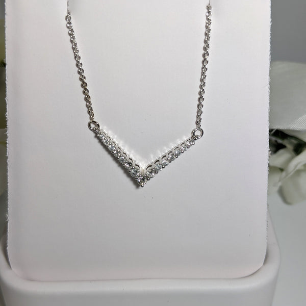 "Constructed of 10K white gold and set with .38cttw in round brilliant cut diamonds this is a stunning piece that will wear well with jeans or that little black dress! Total length of necklace to tip of the V is 18"" inches. $425.00"
