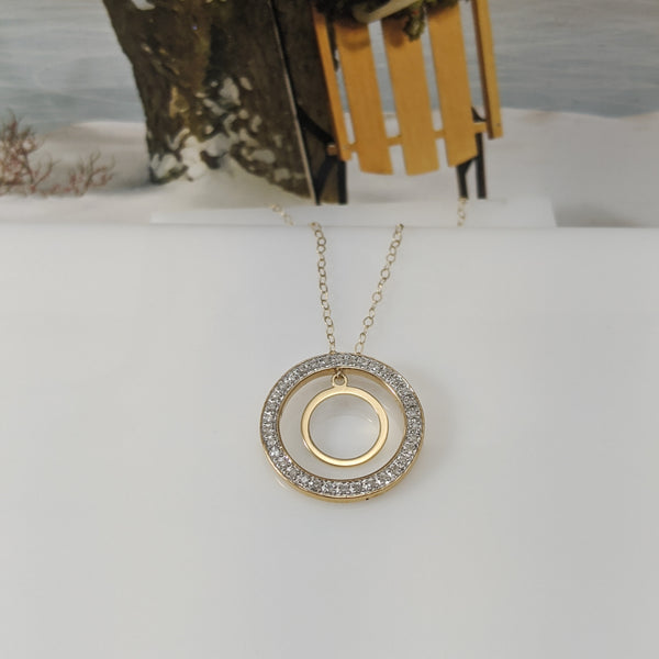 The pendant mounting is constructed of 10k yellow gold and contains .12cttw in round brilliant cut diamonds. Pendant is hung on an 18 inch light link chain. $275.00
