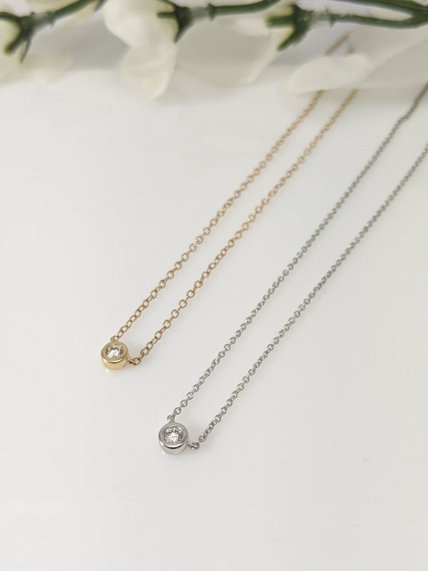 14k yellow gold bezel set diamond pendant
