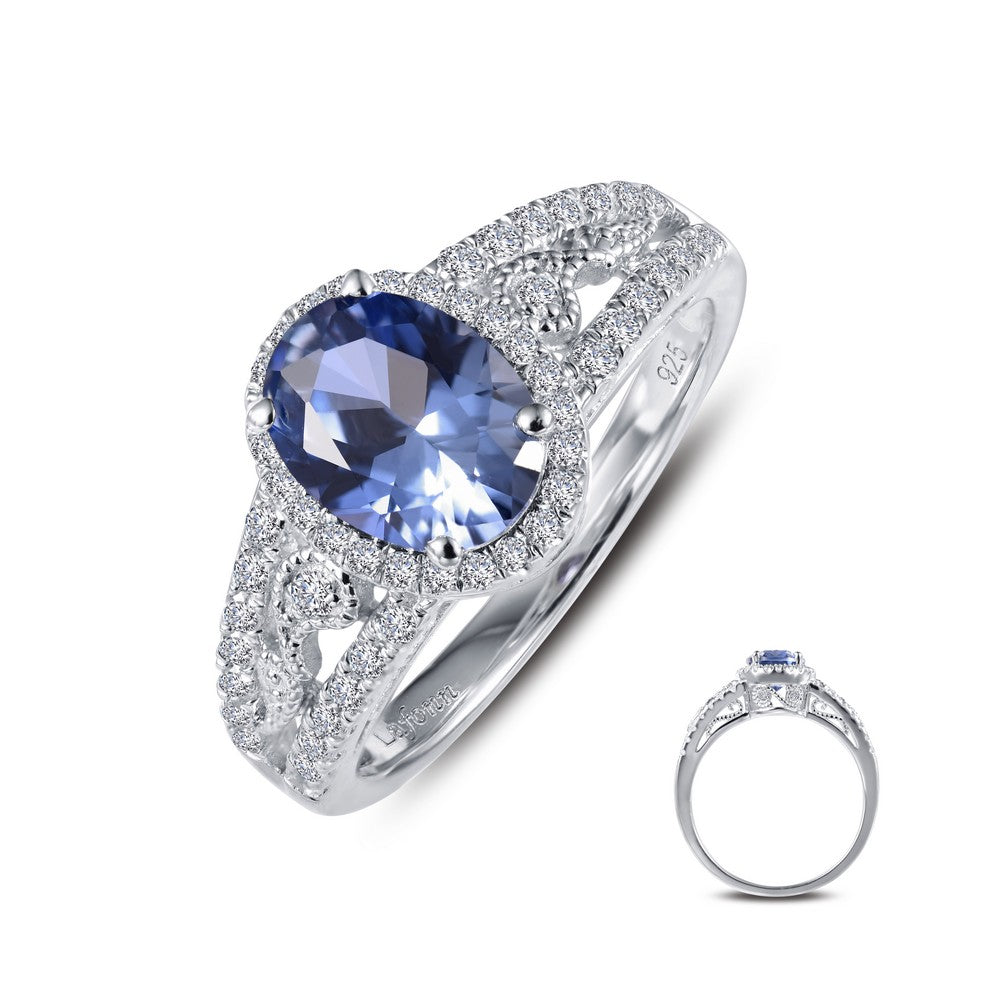 A glamorous and eye-catching statement piece. This vintage-inspired ring features an oval Lafonn Lassaire simulated tanzanite with Lassaire simulated diamonds. This ring is set in sterling silver bonded with platinum. Finger size 7. $195.00
