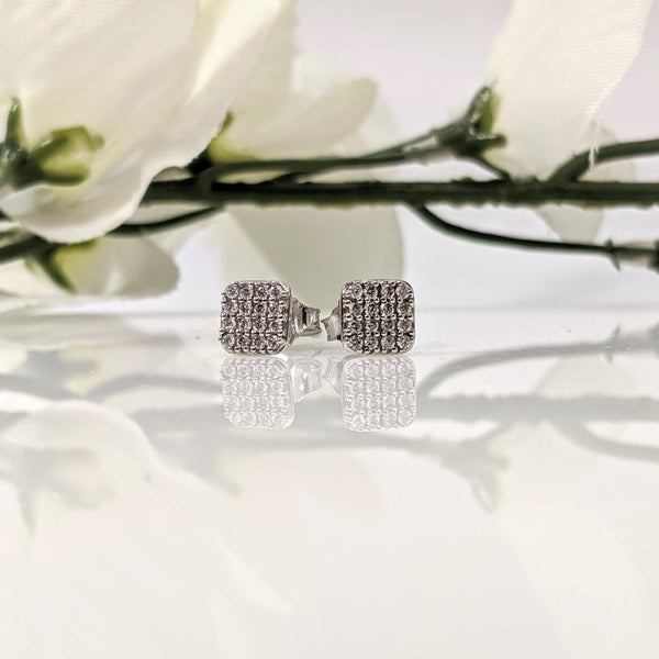 14k white gold multi diamond earrings. These stunning earrings look like they are close to a full carat each when actually the combined total weight of the earrings is .25cttw. Bright and sparkly just in time for the Holidays. $690.00.