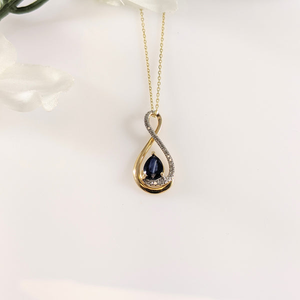 Visible color zoning may not be desirable in gemstones but in this Sapphires case, I'd argue that. I like the stripe in the center of this stone that breaks up varying shades of blue. A swirl of diamonds accent this 22.00mm in length pendant. Lovely and affordable! $350.00  *chain not included