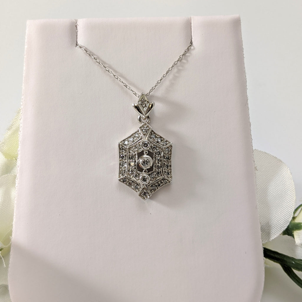 "Stunning 14K white gold and diamond vintage inspired pendant!  .30cttw in round brilliant cut diamonds sparkle and draw the eye to this lovely pendant. Hung on an 18"" inch 14k light white gold chain. Only $450.00!"