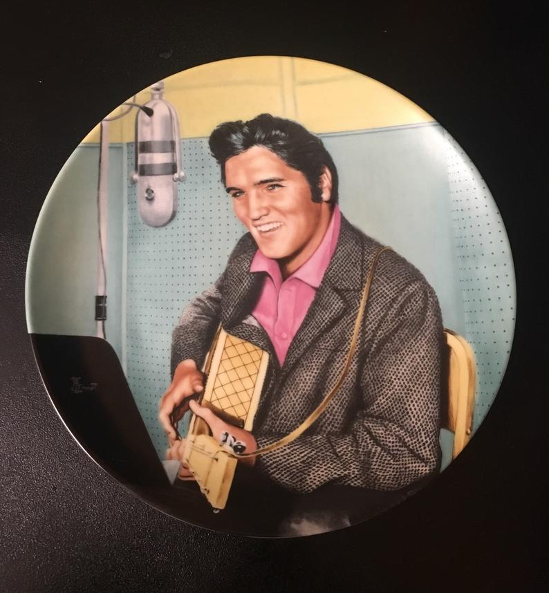 Elvis Presley Looking at a Legend Plate
