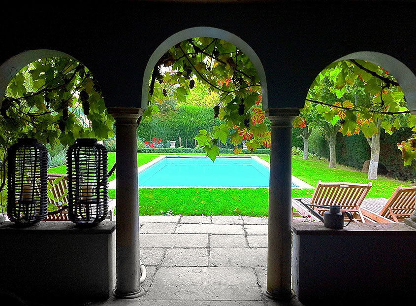 Swimming pool view through arches