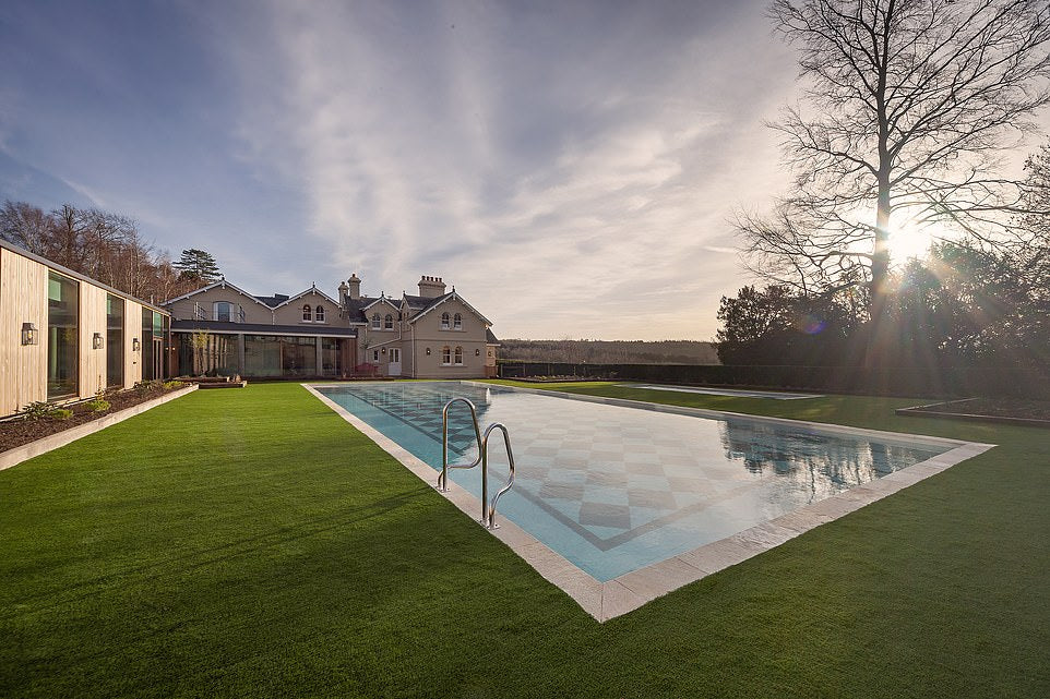 Stunning chequerboard tiled pool with an immaculate lawn surround