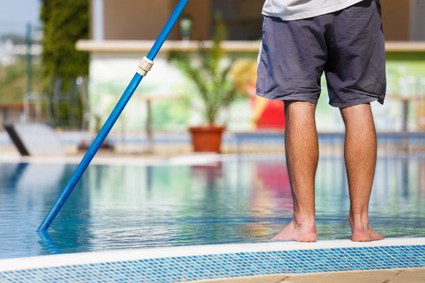 Clean the interior walls of your pool with a pool brush
