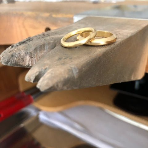 Two solid 18ct gold rings
