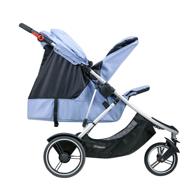 phil&teds dash lightweight inline stroller with main seat lie flat and double kit in parent facing position with toddler in blue marl 3 qtr view_blue marl