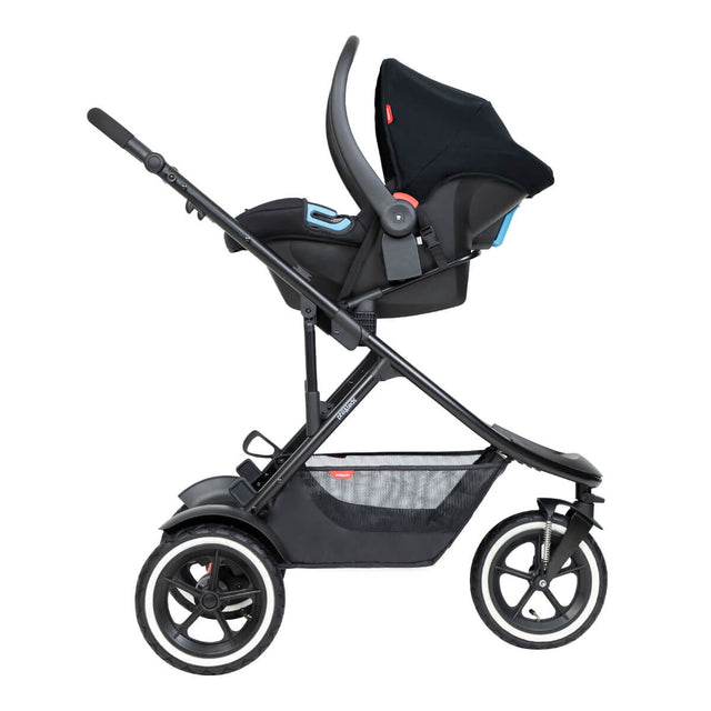 alpha™ infant car seat shown as a travel system using optional travel adaptors on a phil&teds® go™ buggy