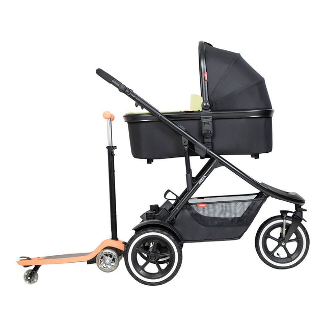 phil&teds inline sport buggy with snug carrycot in lie flat mode and freerider in rear