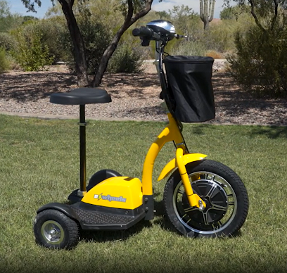 Image shows side view of EWheels EW-18 electric tricycle scooter e-trike in yellow color resting on grass