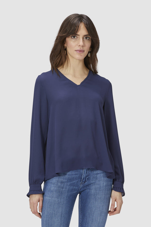 Blouse with pleated back section