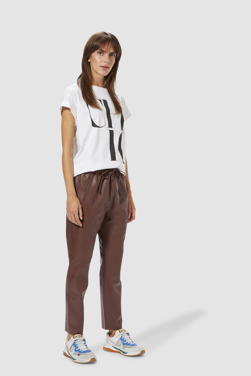 Rich & Royal - Fake leather jogger-style trousers - model image front
