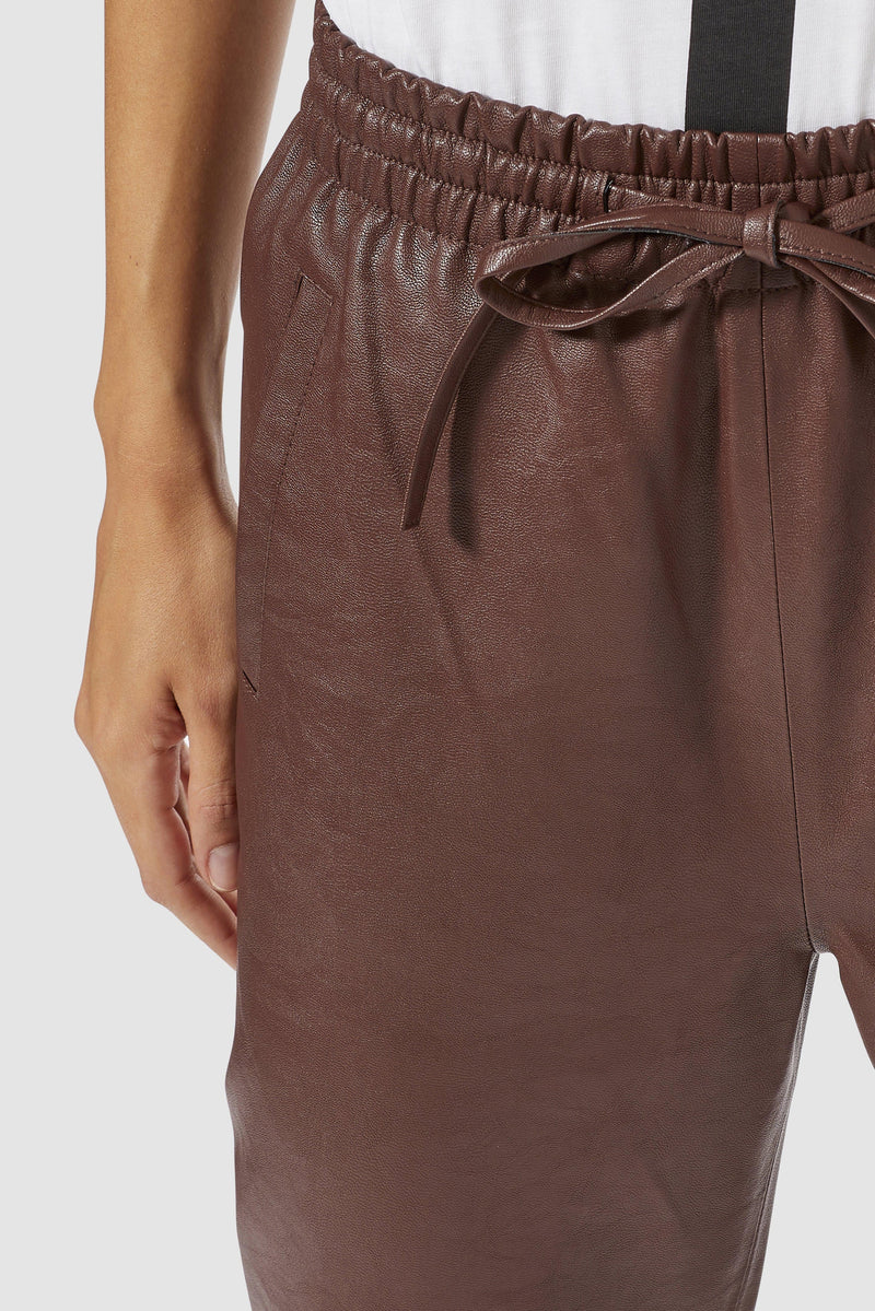 Rich & Royal - Fake leather jogger-style trousers - detail view