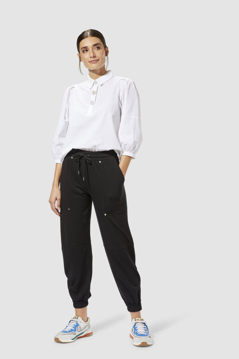 Rich & Royal - Refined jogger-style trousers with shiny decorative rivets - model image front