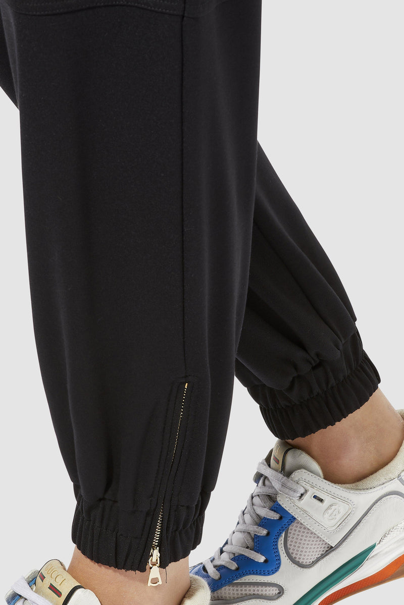 Rich & Royal - Refined jogger-style trousers with shiny decorative rivets - detail view