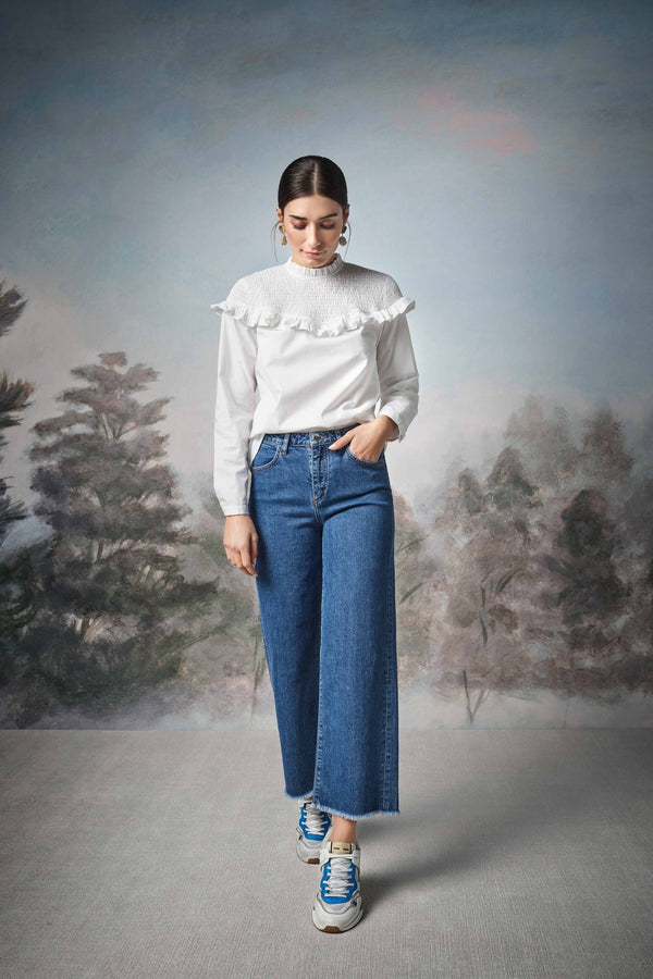 Straight-cut jeans with fringed hem