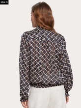 Load image into Gallery viewer, Printed long sleeve ruffle neckline top