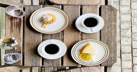 a pair of dishes and a cup of coffee