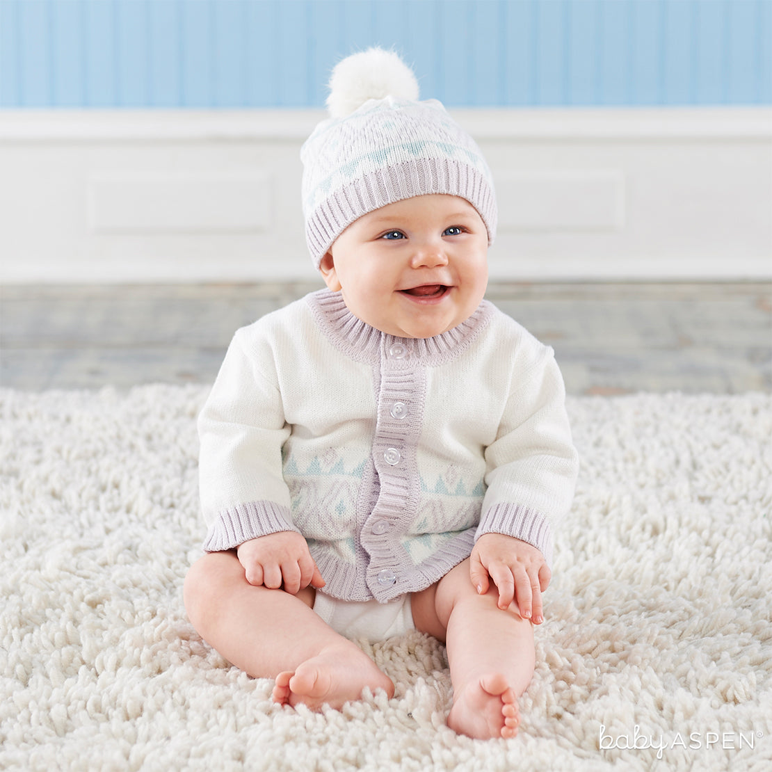 White Fair Isle Cardigan and Pom Pom Hat | 9 Ideas to Keep Baby Warm This Winter | Baby Aspen