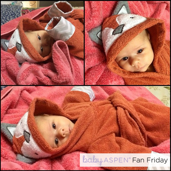 An Adorable Baby Aspen Fan Bundled Up In a Fox Robe