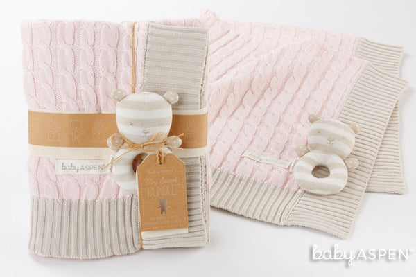 Pink cable knit baby blanket from Baby Aspen