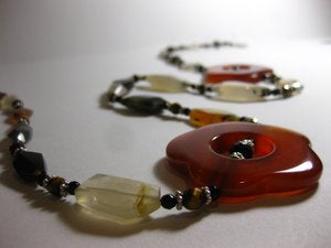 I created a one of a kind Nomi necklace using Carnelian and Agate stones.