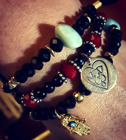 Stackable bracelets featuring Amy Delson's custom made Stray from the Heart bracelet