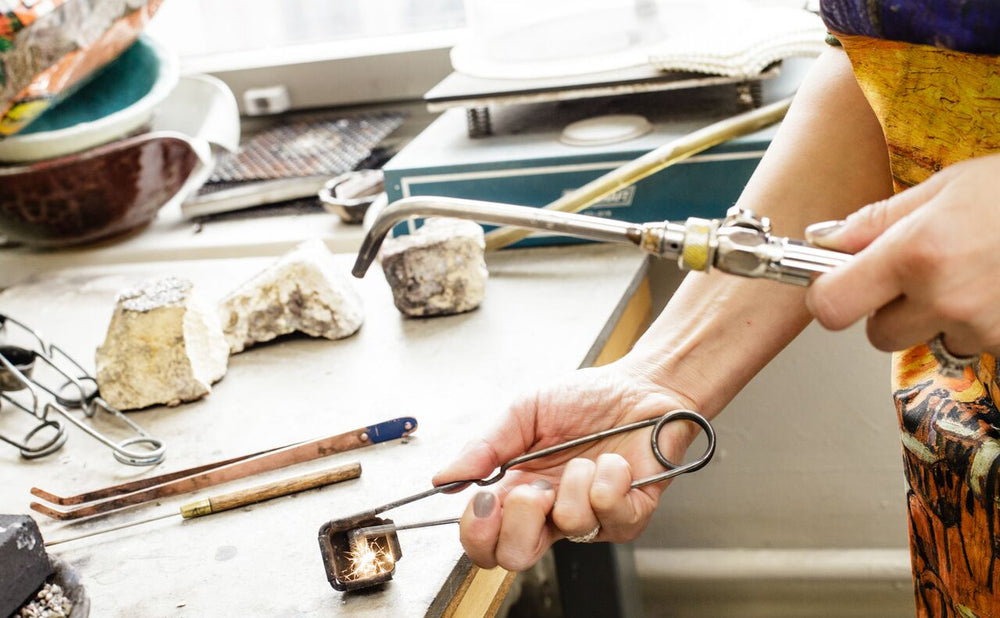 Amy Delson solders jewelry on the Upper East Side of Manhattan