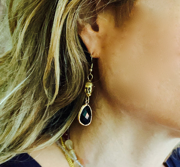 Cindy wears Amy Delson Jewelry Buddha Earrings