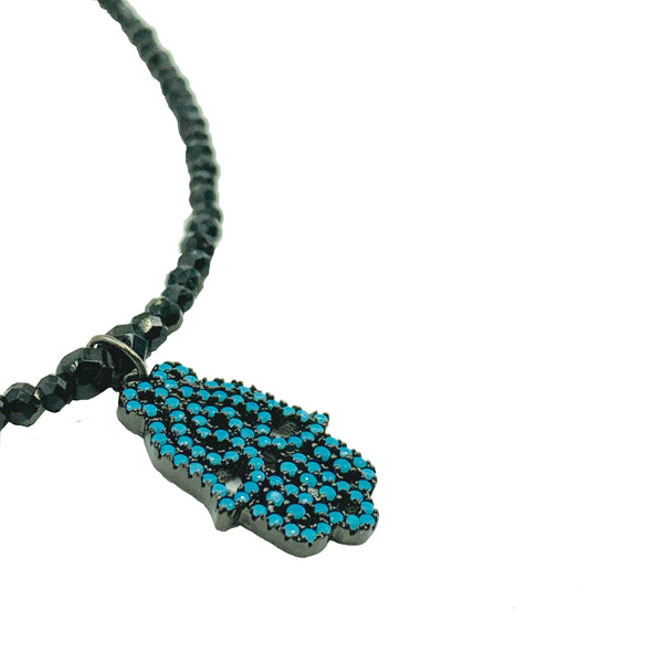 Turquoise hamsa black spinel necklace by Amy Delson Jewelry