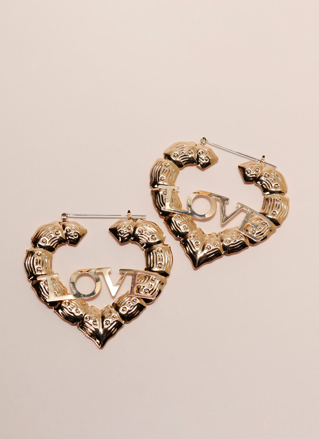 """All you need is love"" statement earrings"