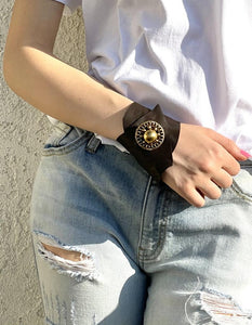 Leather cuff with vintage button closure