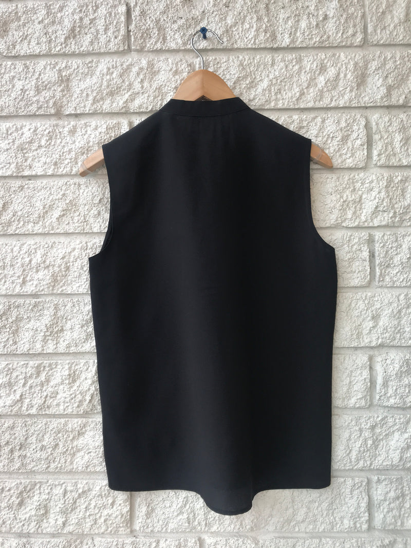 SLEEVELESS FLUTTER BLOUSE
