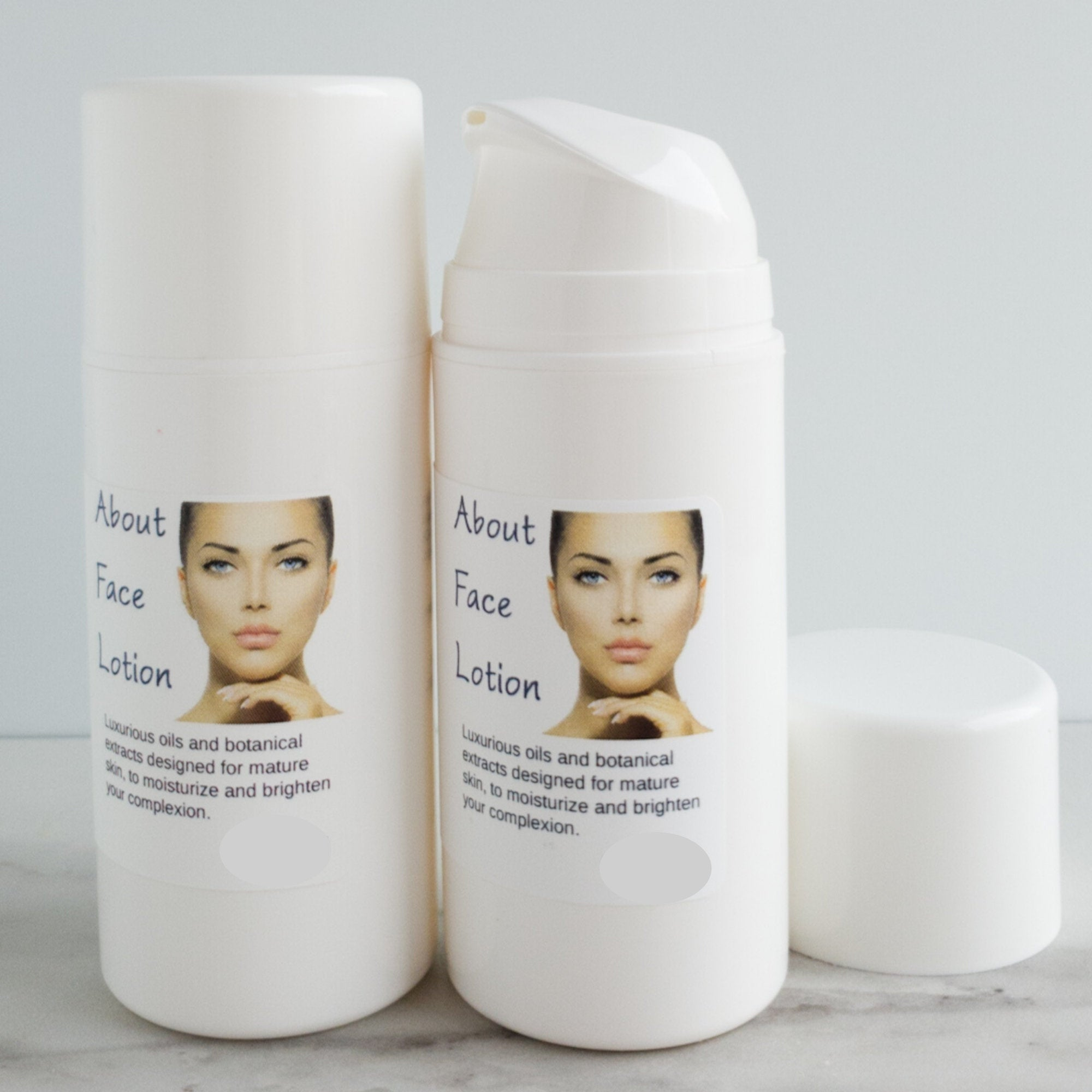 Two bottles of About Face Lotion for mature skin.