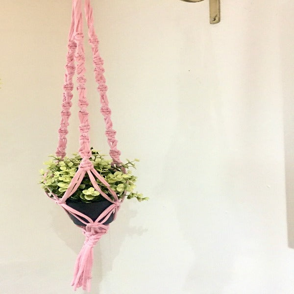 Beautifully handcrafted macrame plant hanger. Made from 100% cotton T shirt Fabric. 40cm metal or wooden ring for easy hanging.