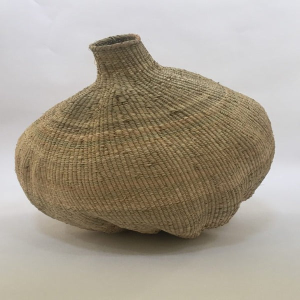 hand woven palm leaf gourd shaped basket for decor purposes