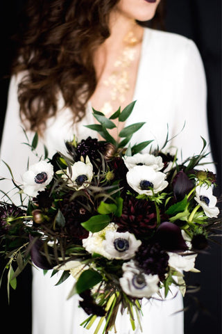 White and black bridal bouquet anemone and calla lilies