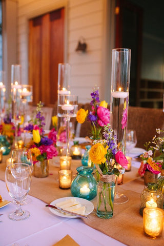 Bright Floral Centerpieces and Floating Candles