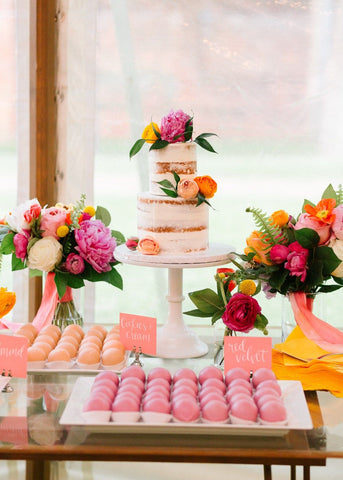 Colorful blooms on wedding cake