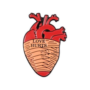 Love Hurts Anatomical Heart Pin