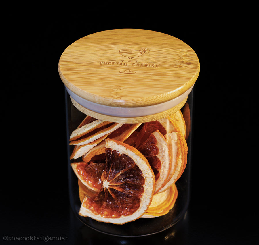 Eco friendly glass jar in an airtight bamboo lid for all your dried goods! Beautifully dehydrated Red Dragon Fruit wheels for your cocktails, mocktails and teas. Grown locally in Southern California, handcrafted and made in the USA. Find them at The Cocktail Garnish at www.thecocktailgarnish.com. Orange navels, cara caras, clementines, lemons, limes and grapefruit. Premium dehydrated citrus and other seasonal garnishes for all occasions and beverages
